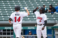 Indianapolis Indians Eric Wood (14) is congratulated by Trayvon Robinson (6) after hitting a home run during an International League game against the Columbus Clippers on April 30, 2019 at Victory Field in Indianapolis, Indiana. Columbus defeated Indianapolis 7-6. (Zachary Lucy/Four Seam Images)