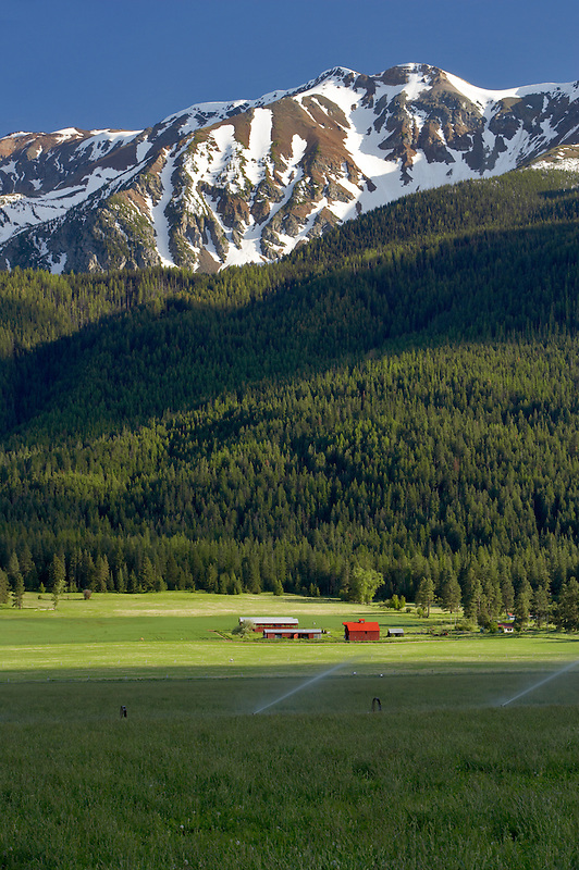 Farmland near Joseph with barn and Wallowa Mountains. Oregon