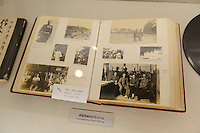 Book with photos of German prisoners of war imprisoned in the Bando camp during WW1, The German House, Naruto, Tokushima Prefecture, Japan, July 9, 2014. The city of Naruto in Tokushima Japan is famous for whirlpools that form in the Naruto Strait. It is home to Otani pottery and the first two temples on the Shikoku 88 temple pilgrimage.
