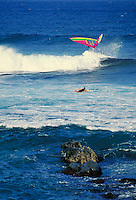 windsurfer jumping waves. Hawaii, Maui.