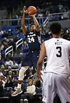 Utah State's JoJo McGLaston (24) shoots over Nevada's AJ West (3) during an NCAA college basketball game in Reno, Nev., on Tuesday, Jan. 20, 2015. (AP Photo/Cathleen Allison)