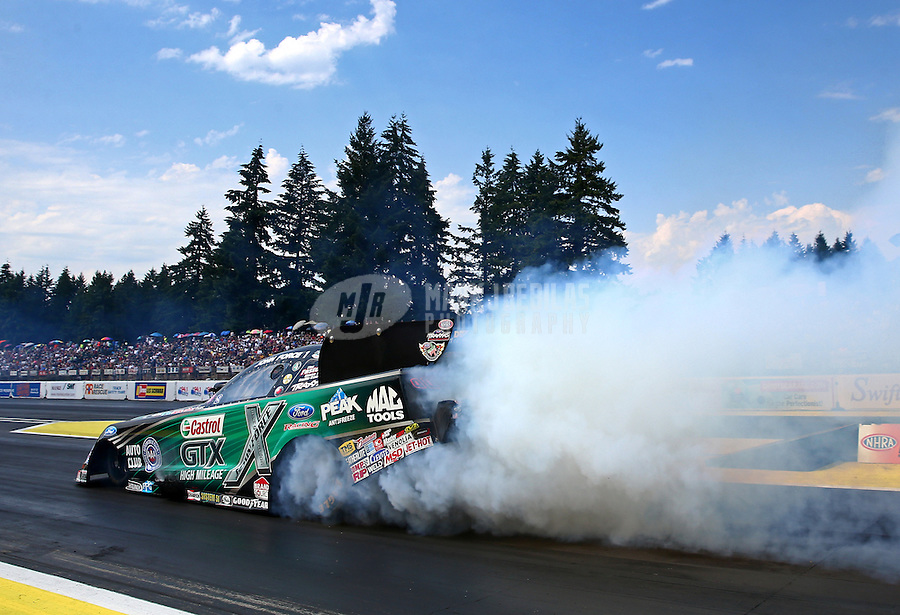 Aug. 2, 2014; Kent, WA, USA; NHRA funny car driver John Force during qualifying for the Northwest Nationals at Pacific Raceways. Mandatory Credit: Mark J. Rebilas-USA TODAY Sports
