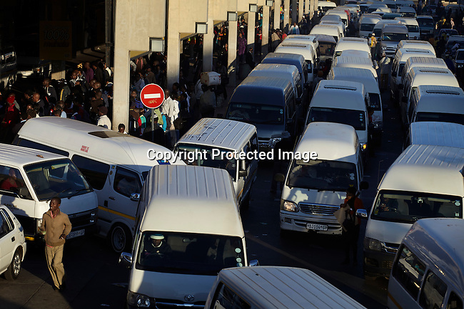 SOWETO, SOUTH AFRICA MAY 3: A view of the morning rush hour on May 3, 2013 at Bara taxi station in Soweto, South Africa. This is Soweto's main taxi station and tens of thousands of people use it every day to commute to work in Johannesburg. The township is a mix of old housing and newly constructed townhouses. A new hungry black middle-class is growing steadily. Many residents work in Johannesburg but the last years many shopping malls have been built, and people are starting to spend their money in Soweto. (Photo by: Per-Anders Pettersson)
