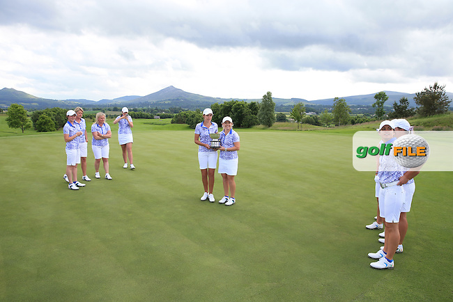 Frolics. Victorious Team GB&amp;I with the 2016 Curtis Cup on the 18th green, played at Dun Laoghaire GC, Enniskerry, Co Wicklow, Ireland. 12/06/2016. Picture: David Lloyd | Golffile. <br /> <br /> All photo usage must display a mandatory copyright credit to &copy; Golffile | David Lloyd.