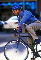 Businessman commutes to work by bicycle.