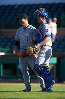 Surprise Saguaros pitcher Damien Magnifico (48) with catcher Zane Evans (6) after closing out an Arizona Fall League game against the Scottsdale Scorpions on October 22, 2015 at Scottsdale Stadium in Scottsdale, Arizona.  Surprise defeated Scottsdale 7-6.  (Mike Janes/Four Seam Images)