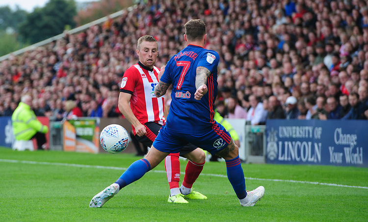 Lincoln City's Joe Morrell vies for possession with Sunderland's Chris Maguire<br /> <br /> Photographer Chris Vaughan/CameraSport<br /> <br /> The EFL Sky Bet League One - Lincoln City v Sunderland - Saturday 5th October 2019 - Sincil Bank - Lincoln<br /> <br /> World Copyright © 2019 CameraSport. All rights reserved. 43 Linden Ave. Countesthorpe. Leicester. England. LE8 5PG - Tel: +44 (0) 116 277 4147 - admin@camerasport.com - www.camerasport.com