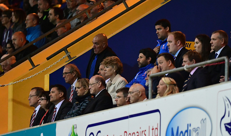 Lincoln City manager Danny Cowley, centre, watches the second half from the directors box after being sent to the stand by referee David Webb<br /> <br /> Photographer Chris Vaughan/CameraSport<br /> <br /> The EFL Checkatrade Trophy - Mansfield Town v Lincoln City - Tuesday 29th August 2017 - Field Mill - Mansfield<br />  <br /> World Copyright &copy; 2018 CameraSport. All rights reserved. 43 Linden Ave. Countesthorpe. Leicester. England. LE8 5PG - Tel: +44 (0) 116 277 4147 - admin@camerasport.com - www.camerasport.com