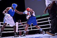 Fairfax, VA - July 1, 2015: Jay Gregory of the Metropolitan Police-London, England, delivers a punch to Darnell Hamilton (l) of the Kansas City Fire Department during a boxing match at the World Police and Fire Games at the George Mason University July 1, 2015.   (Photo by Don Baxter/Media Images International)