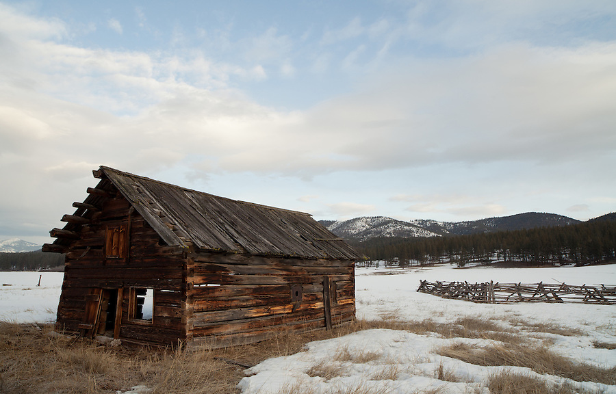 An abandoned home sits in the snow-covered pastures of Central Montana.