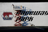 May 30, 2013; Englishtown, NJ, USA: A man touches up the paint on the sound wall behind the starting line of Raceway Park logo. Mandatory Credit: Mark J. Rebilas-
