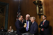 WASHINGTON, DC - SEPTEMBER 27:  Senate Judiciary Committee members (-R) Sen. Ted Cruz (R-TX), Sen. John Cornyn (R-TX) and Sen. Lindsey Graham (R-SC) talk during a break in Judge Brett Kavanaugh's Supreme Court confirmation hearing in the Dirksen Senate Office Building on Capitol Hill September 27, 2018 in Washington, DC. Kavanaugh was called back to testify about claims by Christine Blasey Ford, who has accused him of sexually assaulting her during a party in 1982 when they were high school students in suburban Maryland.  (Photo by Win McNamee/Getty Images)