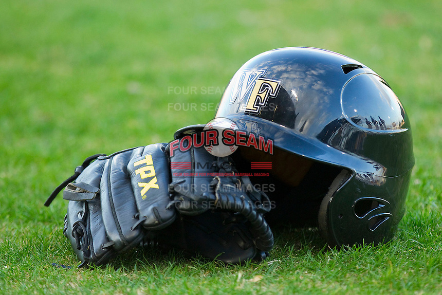 A Wake Forest Demon Deacons batting helmet and glove on the field at Alex Box Stadium on February 18, 2011 in Baton Rouge, Louisiana.  The Tigers defeated the Demon Deacons 15-4.  Photo by Brian Westerholt / Four Seam Images