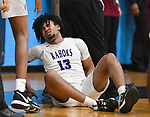Collinsville guard RaySean Taylor grimaces in pain after he fell hard as he was going up for a layup. Belleville West played Collinsville in the Class 4A Belleville East regional basketball championship game at Belleville East High School in Belleville, Illinois on Friday March 6, 2020. <br /> Tim Vizer/Special to STLhighschoolsports.com