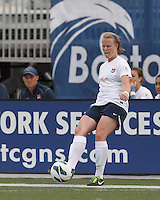 Sky Blue FC defender Courtney Goodson (2) passes the ball.  In a National Women's Soccer League Elite (NWSL) match, Sky Blue FC (white) defeated the Boston Breakers (blue), 3-2, at Dilboy Stadium on June 16, 2013.