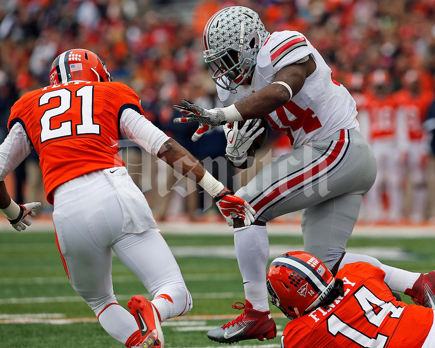Ohio State Buckeyes running back Carlos Hyde (34) stumbles over Illinois Fighting Illini safety Eric Finney (14) and Illinois Fighting Illini defensive back Zane Petty (21) in the first quarter of their game at Memorial Stadium in Champaign, Ill on November 16, 2013. (Columbus Dispatch photo by Brooke LaValley)