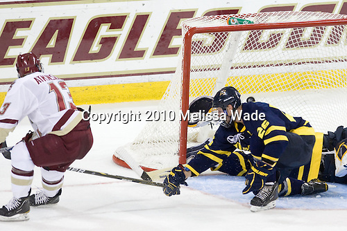 Cam Atkinson (BC - 13) watches his shot go over Joe Cannata (Merrimack - 35) and tie the game at 1 with 32 seconds remaining in the second period. - The Boston College Eagles defeated the visiting Merrimack College Warriors 3-2 on Friday, October 29, 2010, at Conte Forum in Chestnut Hill, Massachusetts.