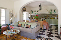 A wide arch divides the open-plan living and kitchen/dining area