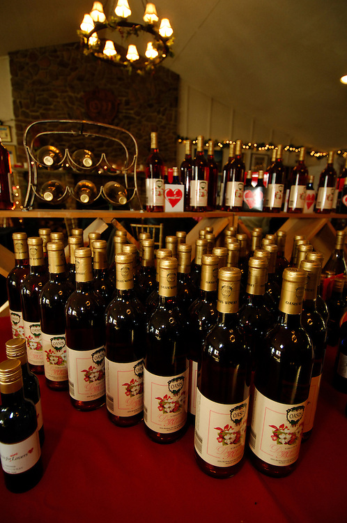 Bottles of wines wait in the tasting room of Oasis Winery. Oasis says in their brochure that they are rated top 10 in the world. The vineyards are located in Hume Virginia.