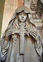 Pictures of a borgeoise realistic style stone sculpture of a girl holding a crucifix on the Poggi Family Tomb. The monumental tombs of the Staglieno Monumental Cemetery, Genoa, Italy