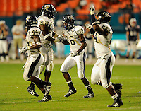 29 November 2008:  FIU defensive lineman Jarvis Penerton (96), defensive end Quentin Newman (54) and linebacker Scott Bryant (44) celebrate the interception by defensive back Franklin Brown (16) with 3:23 left in the fourth quarter of the FAU 57-50 overtime victory over FIU in the annual Shula Bowl at Dolphin Stadium in Miami, Florida.