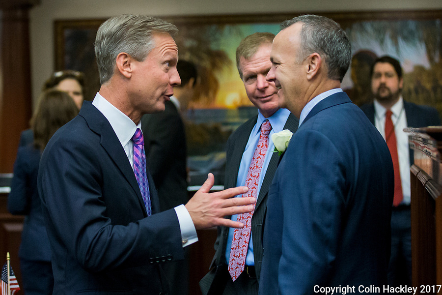 TALLAHASSEE, FLA. 3/7/17-Former House  Speakers Dean Cannon, left and Tom Feeney, talk with House Speaker Richard Corcoran, R-Land O'Lakes, right, during opening day of the legislative session at the Capitol in Tallahassee. <br /> <br /> COLIN HACKLEY PHOTO