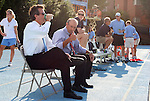 27 September 2009: UNC assistant coach Bill Palladino gives the thumbs up sign seated between head coach Anson Dorrance (left) and assistant coach Cindy Parlow (right) before the game. The University of North Carolina Tar Heels defeated the Wake Forest University Demon Deacons 4-0 at Fetzer Field in Chapel Hill, North Carolina in an NCAA Division I Women's college soccer game.