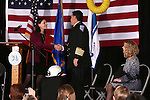 Ashley Carrington, with U.S. Sen. Dean Heller's office, congratulates Carson City Fire Chief Bob Schreihans at his badge-pinning ceremony at Station 51 in Carson City, Nev., on Tuesday, Feb. 3, 2015. <br /> Photo by Cathleen Allison