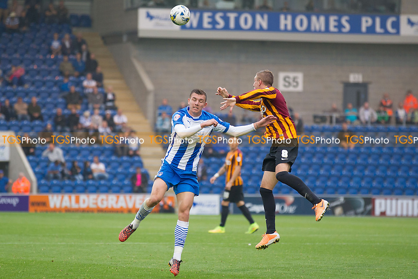 Gary Liddle of Bradford City out jumps Alex Gilbey of Colchester United - Colchester United vs Bradford City - Sky Bet League One Football at the Weston Homes Community Stadium, Colchester, Essex - 20/09/14 - MANDATORY CREDIT: Ray Lawrence/TGSPHOTO - Self billing applies where appropriate - contact@tgsphoto.co.uk - NO UNPAID USE