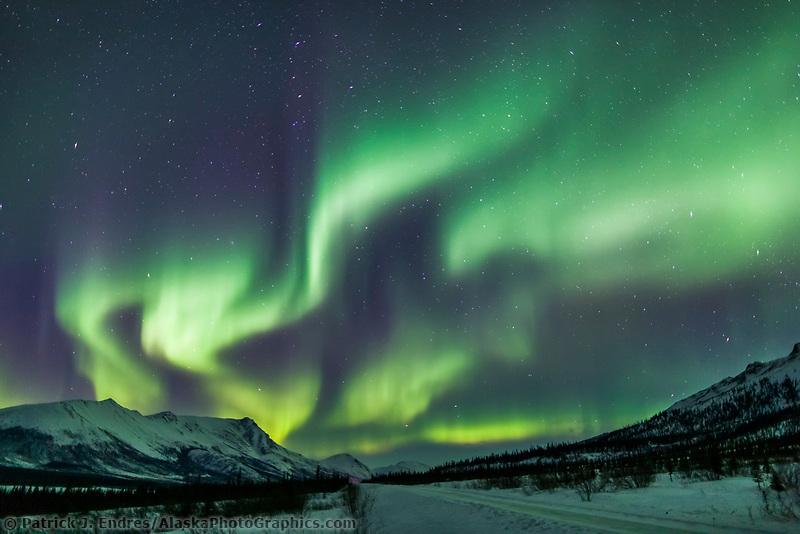 Aurora borealis over the Brooks range mountains and the James Dalton Highway, arctic, Alaska.