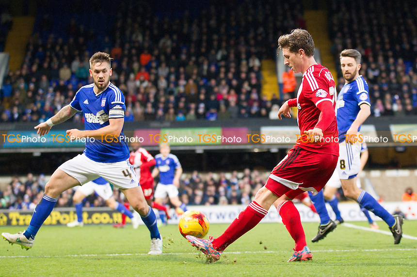 Adam Reach, Middlesbrough crosses as Luke Chambers of Ipswich Town looks to close down - Ipswich Town v Middlesbrough - Sky Bet Championship Football  at Portman Road, Ipswich, Suffolk  - 20/12/14 - MANDATORY CREDIT: Ray Lawrence/TGSPHOTO - Self billing applies where appropriate - contact@tgsphoto.co.uk - NO UNPAID USE