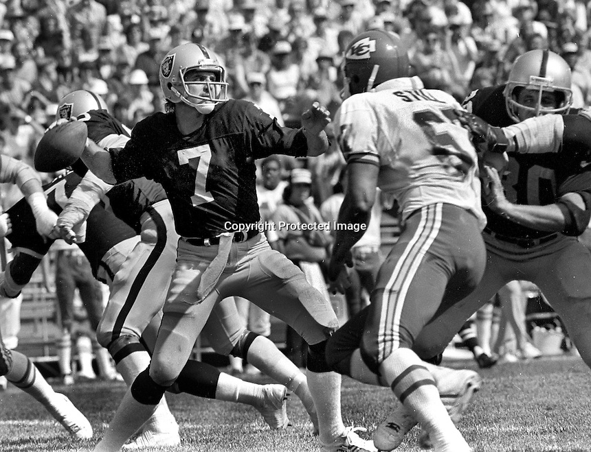 Oakland Raider QB Dan Pastorini was injured on this play, Oct 5,1980.against Kansas City Chiefs.<br />(1980 photo/Ron Riesterer)