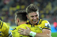 Beauden Barrett congratules Wes Goosen on his try during the Super Rugby match between the Hurricanes and Chiefs at Westpac Stadium in Wellington, New Zealand on Friday, 27 April 2019. Photo: Dave Lintott / lintottphoto.co.nz