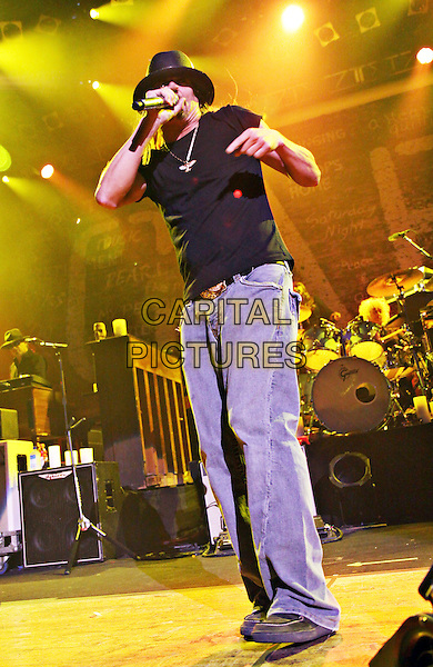 "Kid Rock (Robert James ""Bob"" Ritchie).Ryman Auditorium, Nashville, Tennessee, USA..23rd November 2011.singing performing performance live in concert on stage gig music half length black hat t-shirt singing jeans demim  .CAP/ADM/DGH.©Doug Harris/AdMedia/Capital Pictures."