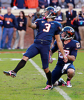 Oct. 22, 2011 - Charlottesville, Virginia - USA; Virginia Cavaliers kicker Robert Randolph (3) kicks a field goal alongside Virginia Cavaliers wide receiver Jacob Hodges (27) during an NCAA football game against the North Carolina State Wolfpack at the Scott Stadium. NC State defeated Virginia 28-14. (Credit Image: © Andrew Shurtleff