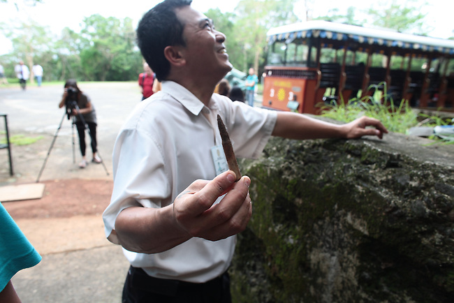 A tour guide displays a corroded World War II-era U.S. rifle cartridge discovered on the Philippine island of Corregidor. Unexploded bullets and even grenades are still routinely found on the former island fortress, which was the scene of heavy fighting in World War II. June 26, 2011.