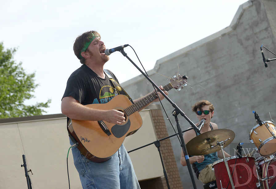 NWA Democrat-Gazette/BEN GOFF @NWABENGOFF<br /> Justin Collier (left) and Tanner Mackey play with their band Surfers of the Omniverse from Springdale in the battle of the bands Saturday, June 17, 2017, during the Rodeo of the Ozarks Western Days on the Shiloh Square in downtown Springdale. The event, held at Parsons Stadium in previous years, featured a barbecue cook off, stage coach rides, a battle of the bands and more.