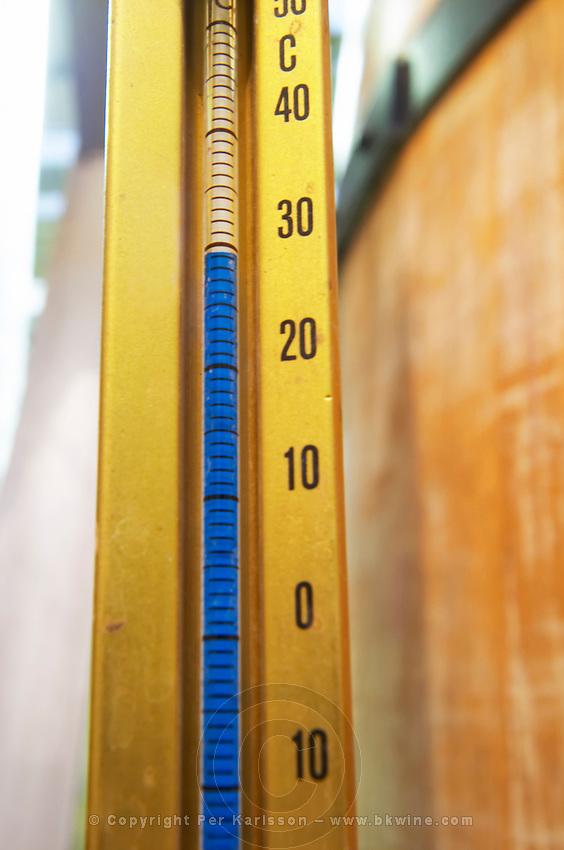 Thermometer on fermentation vat showing high temperature dom du vieux telegraphe chateauneuf du pape rhone france