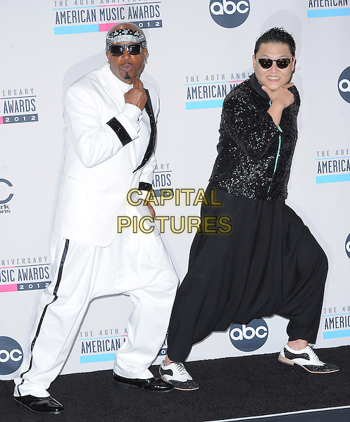 MC HAMMER (Stanley Kirk Burrell) & Psy (Park Jae sang).40th Anniversary American Music Awards - Press Room held at Nokia Theatre L.A. Live, Los Angeles, California, USA..November 18th, 2012.AMA AMAs full length black white suit bandana sunglasses shades hands arms posing  harem trousers sequins sequined jacket.CAP/DVS.©DVS/Capital Pictures.