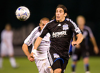 18 April 2009: Nick Garcia of the Earthquakes tries to control the ball away from Galaxy defender during the game at Oakland-Alameda County Coliseum in Oakland, California.   Earthquakes and Galaxy are tied 1-1.