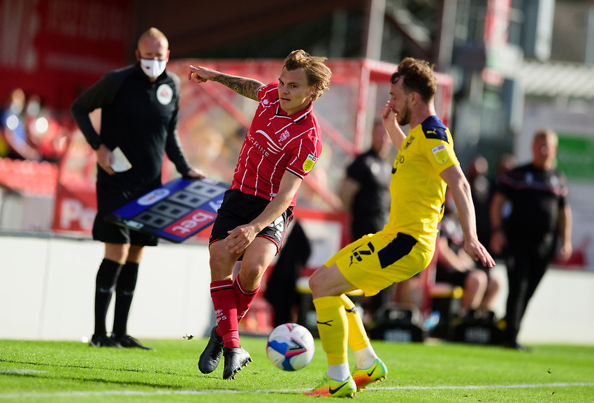 Lincoln City's Harry Anderson battles with Oxford United's Sam Long<br /> <br /> Photographer Andrew Vaughan/CameraSport<br /> <br /> The EFL Sky Bet League One - Saturday 12th September  2020 - Lincoln City v Oxford United - LNER Stadium - Lincoln<br /> <br /> World Copyright © 2020 CameraSport. All rights reserved. 43 Linden Ave. Countesthorpe. Leicester. England. LE8 5PG - Tel: +44 (0) 116 277 4147 - admin@camerasport.com - www.camerasport.com - Lincoln City v Oxford United