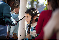 Pictured: Young girls playing Thursday 03 March 2016<br /> Re: Migrants have been gathering at the port of Piraeus, near Athens, Greece