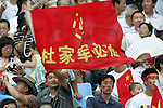 10 August 2008: Unidentified China fan waves a flag.  China played in the second game of the night against Belgium.  The men's Olympic soccer team of Belgium defeated the men's Olympic soccer team of China 2-0 at Shenyang Olympic Sports Center Wulihe Stadium in Shenyang, China in a Group C round-robin match in the Men's Olympic Football competition.