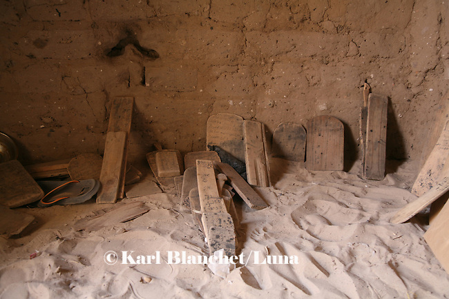 Wooden boards displayed in the house of a marabout in Timbuctu, Mali. They are used like books. Pupils use wooden boards to write versets and read them during hours. The coranic schools in Timbuctu are only open early in the morning and on Saturdays in order to allow pupils to attend the public school.