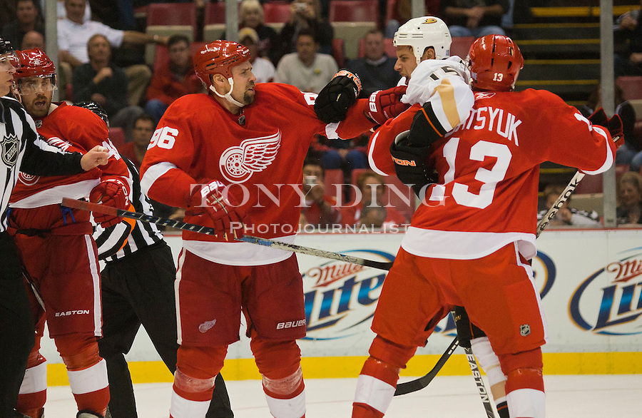 8 October 2010: Anaheim Ducks forward Ryan Getzlaf (15) is pushed back away from Detroit Red Wings forward Tomas Holmstrom (96) by forward Pavel Datsyuk (13) during a scuffle, in the first period of the Anaheim Ducks at Detroit Red Wings NHL hockey game, at Joe Louis Arena, in Detroit, MI...***** Editorial Use Only *****
