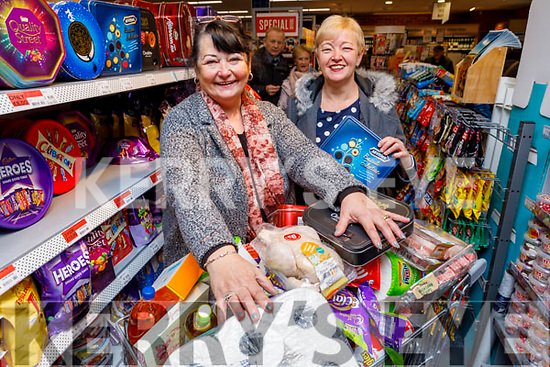 Annie Stack from Ardfert, winner of the Trolley Dash at the reopening of Moriarty's Centra Ballyheigue on Friday to the value of €217 standing with Ciss Duggan from Tralee.