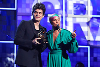 John Mayer, left, and Alicia Keys present the award for song of the year at the 61st annual Grammy Awards on Sunday, Feb. 10, 2019, in Los Angeles. (Photo by Matt Sayles/Invision/AP)