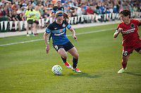 Kansas City, Mo. - Saturday April 23, 2016: FC Kansas City midfielder Heather O'Reilly (9) attempts to keep the ball from Portland Thorns FC defender Meghan Klingenberg (25) during a match at Swope Soccer Village. The match ended in a 1-1 draw.