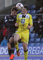 Graham Carey (left) and John McGinn go for the ball in the Ross County v St Mirren Scottish Professional Football League match played at the Global Energy Stadium, Dingwall on 17.1.15.