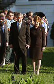 U.S. President George W. Bush and First Lady Laura Bush and of the White House staff bow their heads in prayer to mark the exact moment of the first terrorist attack on the World Trade Center at 8:46 AM two years ago at the White House in Washington, DC on September 11, 2003.<br /> Credit: Ron Sachs / CNP